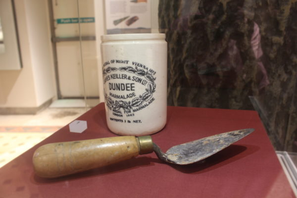 trowel and marmalade jar on display
