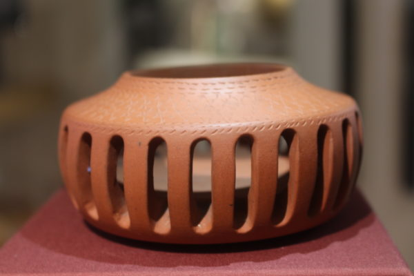 Pottery incense cup with slots.