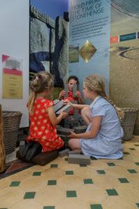 Children building Stonehenge from foam blocks in the Bronze Age gallery
