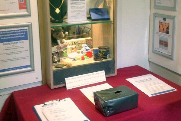 Bidding station table pens and silent bid box