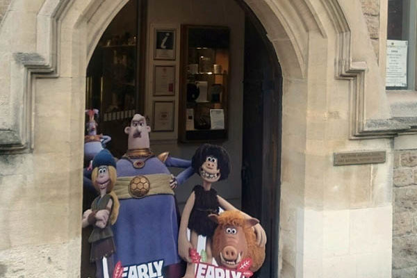 Aardman Early Man cardboard characters in the Wiltshire Museum doorway