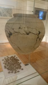 Selection of 100 Roman coins and a large Savernake ware pottery vessel - the Cunetion hoard