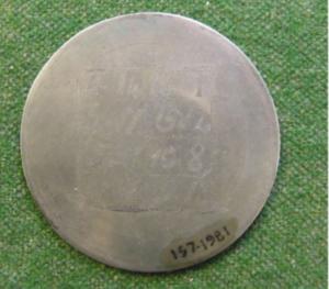 a talisman with faint enscription