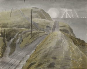 View along a road on top of the Downs above the sea. Searchlights and explosions visible on the horizon beyond.